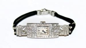 Женские наручные часы с платиновым корпусом